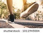 women running on the road for... | Shutterstock . vector #1011945004