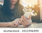 happy woman hand using mobile...   Shutterstock . vector #1011946390