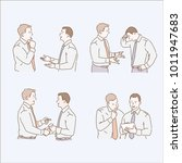 colleagues discussing documents ... | Shutterstock .eps vector #1011947683