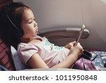 little asian girl listening to... | Shutterstock . vector #1011950848