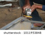 worker sawing metal with a... | Shutterstock . vector #1011953848