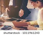 the supervisor is instructing... | Shutterstock . vector #1011961243
