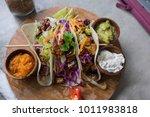 healthy vegan salad tortilla... | Shutterstock . vector #1011983818