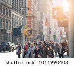 anonymous people walking down...   Shutterstock . vector #1011990403