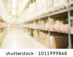 blurred warehouse or storehouse ... | Shutterstock . vector #1011999868