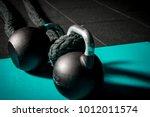 kettle bells  battle rope on... | Shutterstock . vector #1012011574