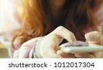 woman use of smartphone at... | Shutterstock . vector #1012017304