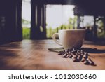 cup of black coffee and coffee... | Shutterstock . vector #1012030660