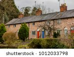cottages and houses a street in ... | Shutterstock . vector #1012033798