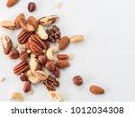 background of nuts   pecan ... | Shutterstock . vector #1012034308