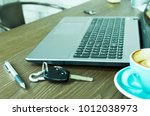 car key and pen and coffee cups ... | Shutterstock . vector #1012038973