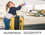 happy baby carries your luggage ... | Shutterstock . vector #1012041979
