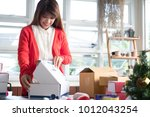 start up small business owner... | Shutterstock . vector #1012043254