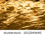 golden water surface splashing... | Shutterstock . vector #1012044640