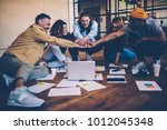 group of young employees using... | Shutterstock . vector #1012045348
