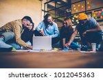 group of designers making...   Shutterstock . vector #1012045363