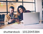 young female employee watching... | Shutterstock . vector #1012045384