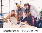 working group discussing ideas... | Shutterstock . vector #1012045399