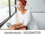 thoughtful beautiful young...   Shutterstock . vector #1012045729