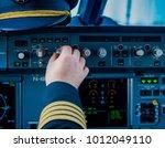 pilot pushing buttons on... | Shutterstock . vector #1012049110
