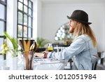 smiling male freelancer has... | Shutterstock . vector #1012051984