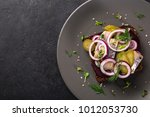 Stock photo open sanwich with dark rye bread beet marinated herring pickled cucumber and red onion black 1012053730