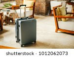 gray plastic suitcase with... | Shutterstock . vector #1012062073