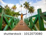 hiking in green tropical jungle ... | Shutterstock . vector #1012073080