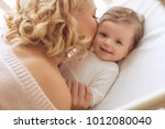 mom with a baby   Shutterstock . vector #1012080040