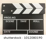 black slate movie on the white... | Shutterstock . vector #1012080190