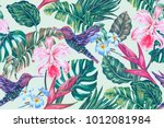 Stock vector floral seamless vector tropical pattern background with exotic flowers palm leaves jungle leaf 1012081984