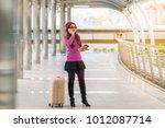 woman traveller using... | Shutterstock . vector #1012087714