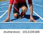 runner athlete starting running ... | Shutterstock . vector #1012100188