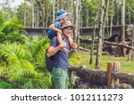 father and son at the zoo.... | Shutterstock . vector #1012111273