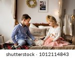 little two children stroking... | Shutterstock . vector #1012114843