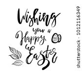 wishing you a happy easter card ... | Shutterstock .eps vector #1012116349