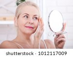 forty years old woman looking... | Shutterstock . vector #1012117009