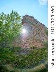 Small photo of Sun shining past wall fragment at the Madenburg castle ruin near Landau in der Pfalz, Germany.