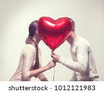 Stock photo valentine couple beauty girl and her handsome boyfriend holding heart shaped air balloon and 1012121983