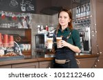 woman making coffee by coffee...   Shutterstock . vector #1012122460