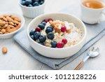 oatmeal porridge bowl with... | Shutterstock . vector #1012128226