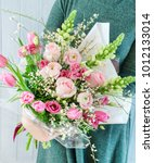 nice bouquet in the hands | Shutterstock . vector #1012133014