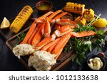 snow crab legs served with... | Shutterstock . vector #1012133638