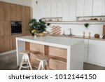 stylish kitchen in white and... | Shutterstock . vector #1012144150