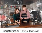 couple of barista are working...   Shutterstock . vector #1012150060