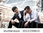 frustrated asian young business ... | Shutterstock . vector #1012150813