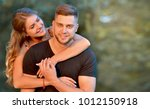happy young couple hugging and...   Shutterstock . vector #1012150918