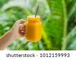 mango smoothie in a glass mason ... | Shutterstock . vector #1012159993