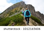 tourists on a trip in dolomites ... | Shutterstock . vector #1012165606