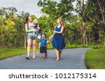 two mothers and two children... | Shutterstock . vector #1012175314